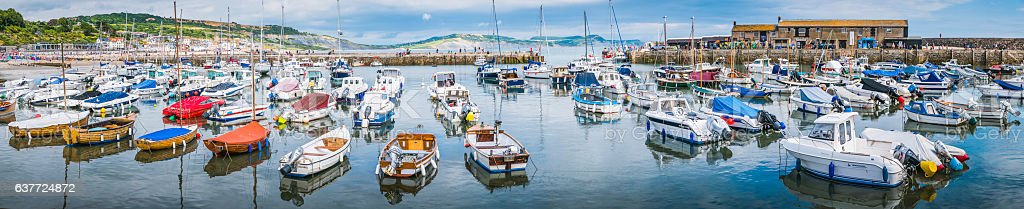 Dorset boats moored in tanquil harbour beside Cobb Lyme Regis stock photo