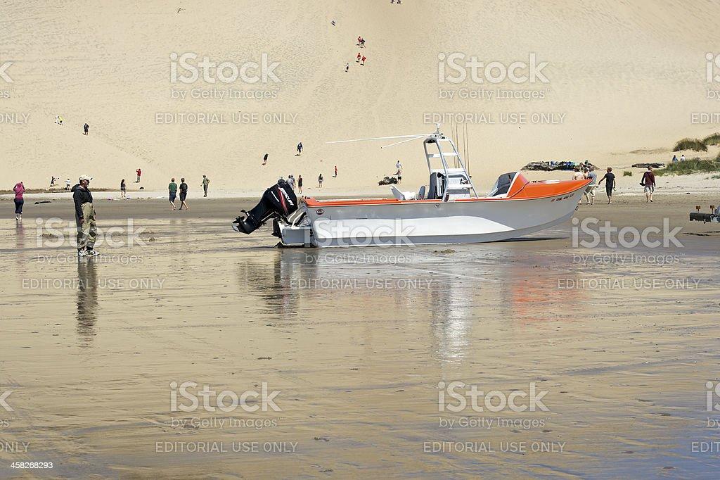 Dory Boat Returning on Sand Cape Kiwanda Pacific City Oregon royalty-free stock photo