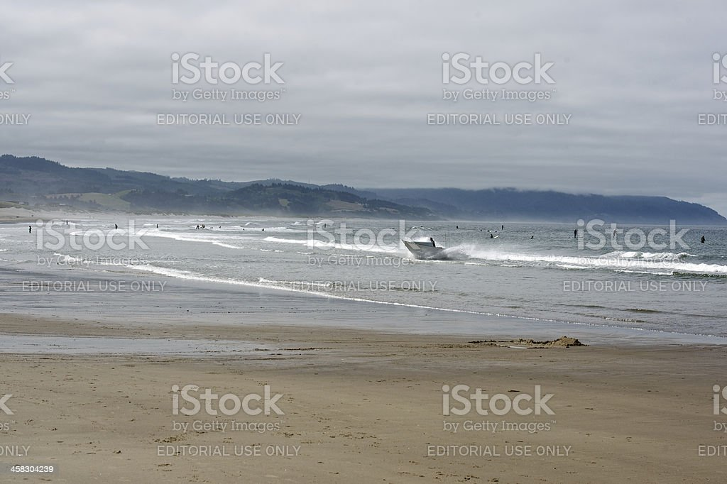 Dory Boat Returning Surf Surfers Cape Kiwanda Pacific City Oregon royalty-free stock photo