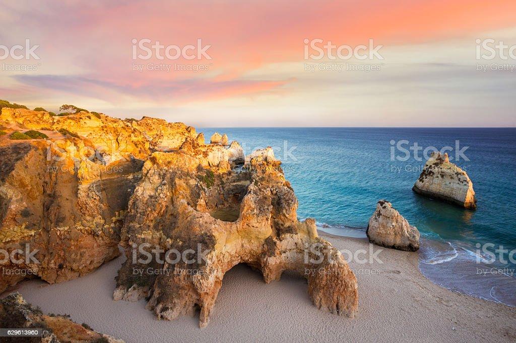 Praia Dos Tres Irmaos at sunset stock photo