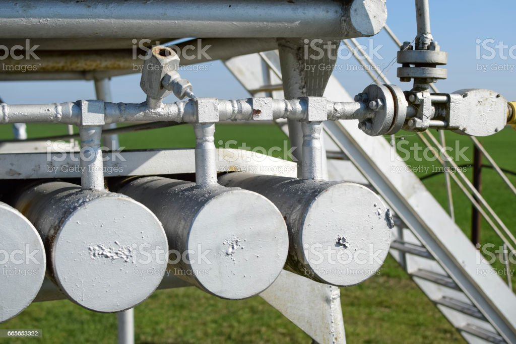 Dosage unit and container with methanol. Additional equipment for oil and gas wells stock photo