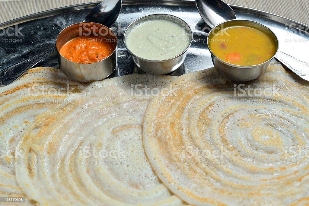 Dosai or Dosa with chutney and sambar stock photo