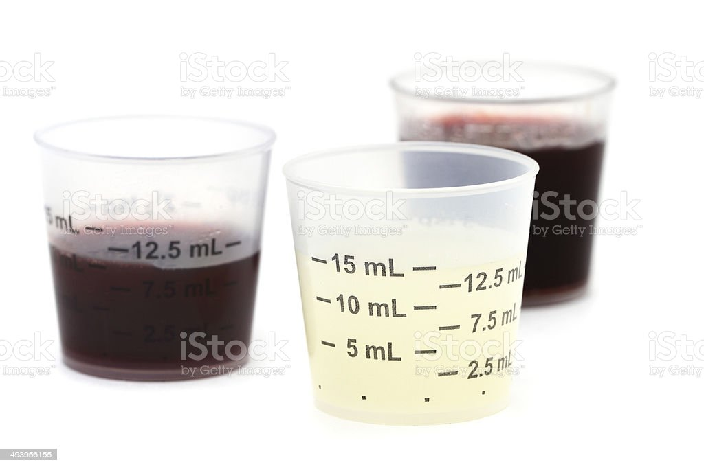 Doses of liquid medication stock photo