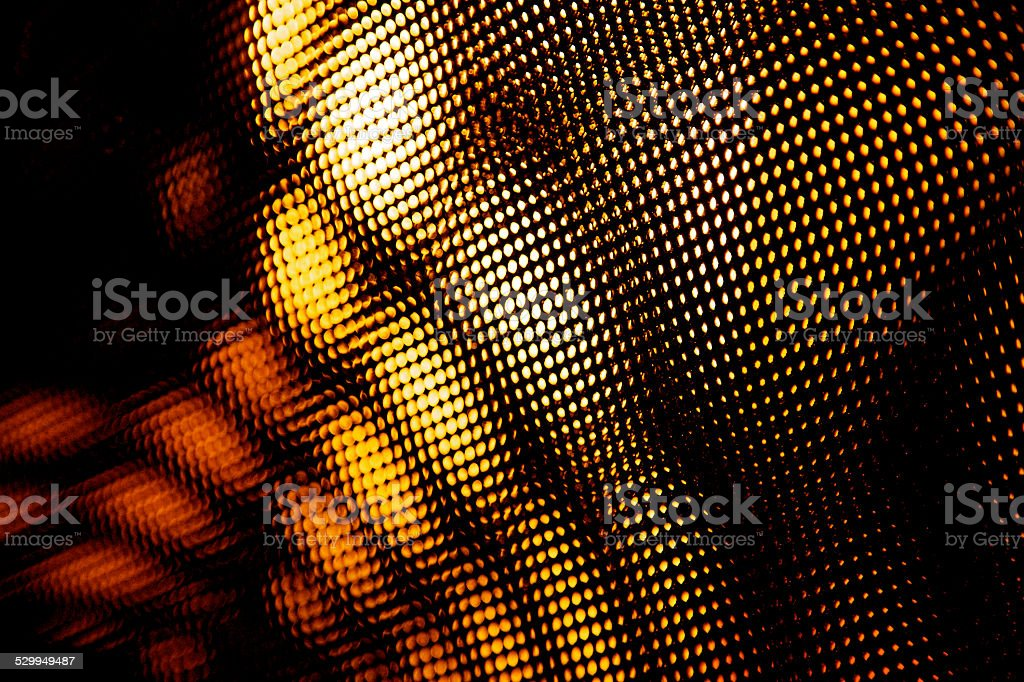 dots and spots net in warm oragne abstract blur stock photo