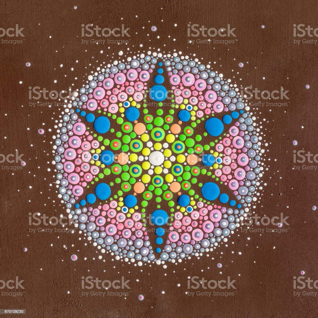 Dots mandala on wood stock photo