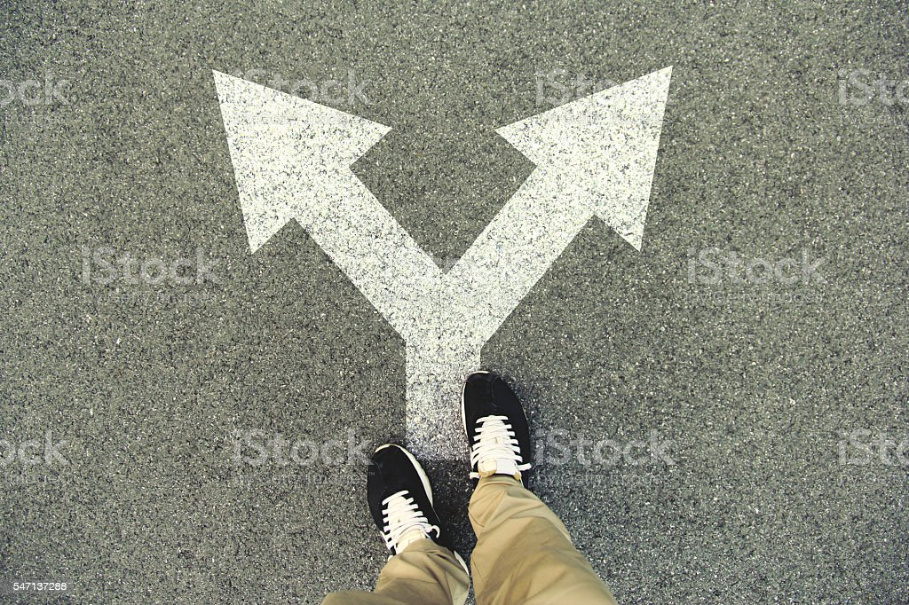 Double arrow painted on an asphalt road stock photo
