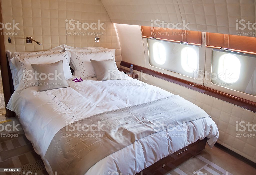 Double bed inside of a business jet stock photo