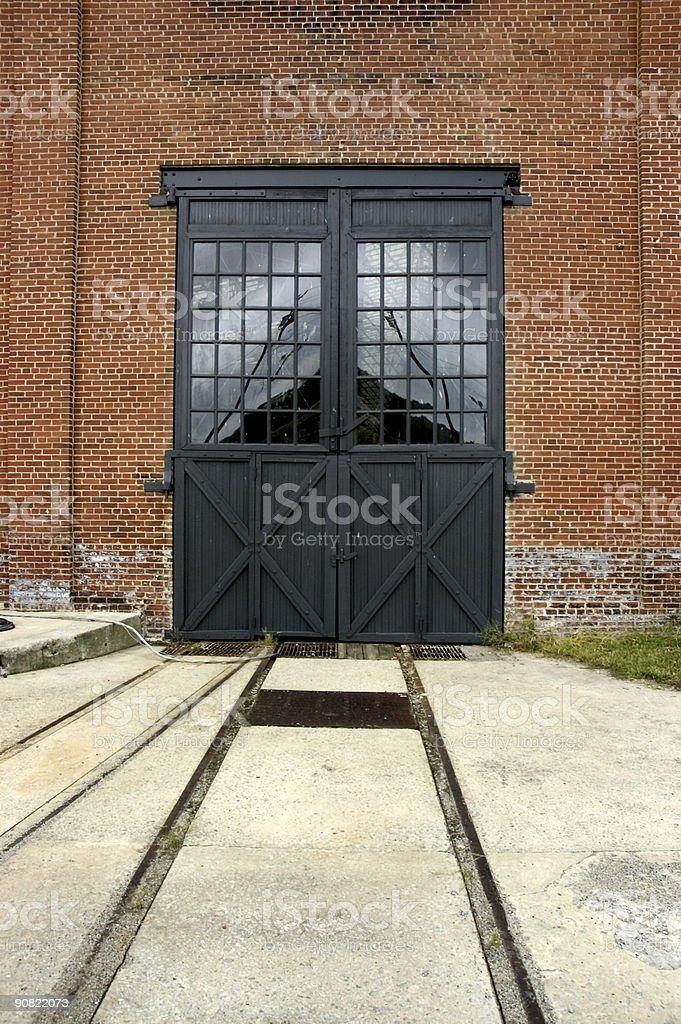 double black doors on railroad tracks royalty-free stock photo
