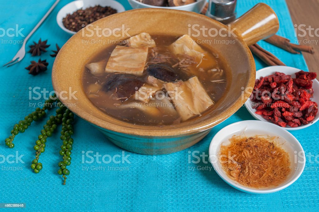Double boiled pork rids, black mushroom in chinese herb soup stock photo