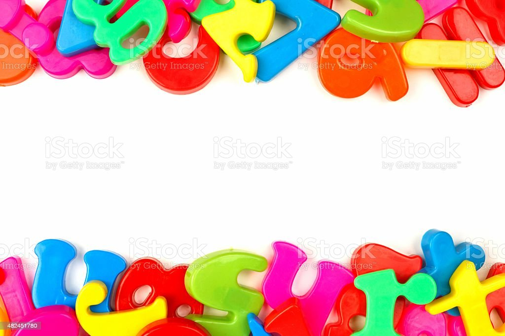 Double border of toy magnetic letters stock photo
