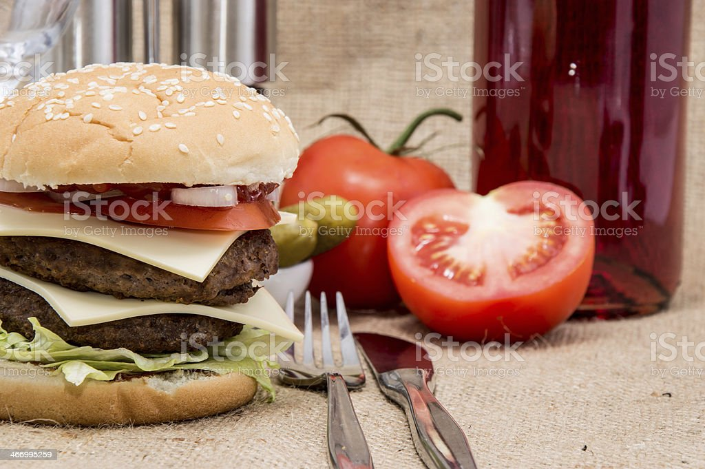 Double Burger with ingredients and cutlery royalty-free stock photo