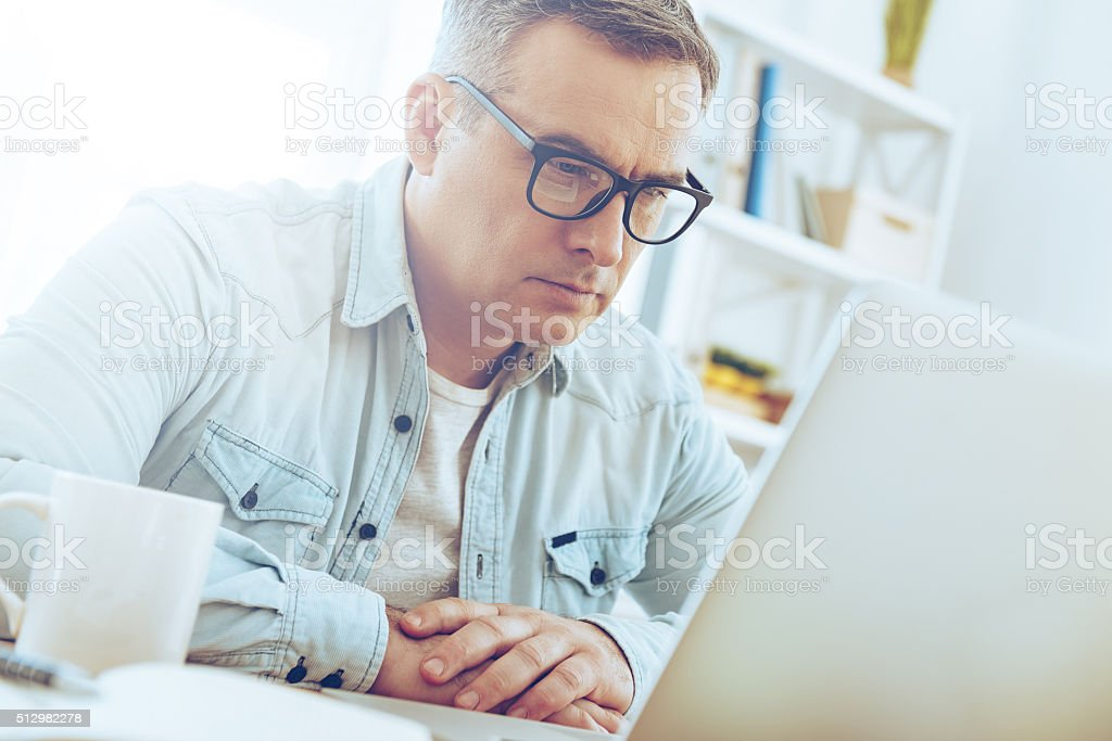 Double checking his work. stock photo