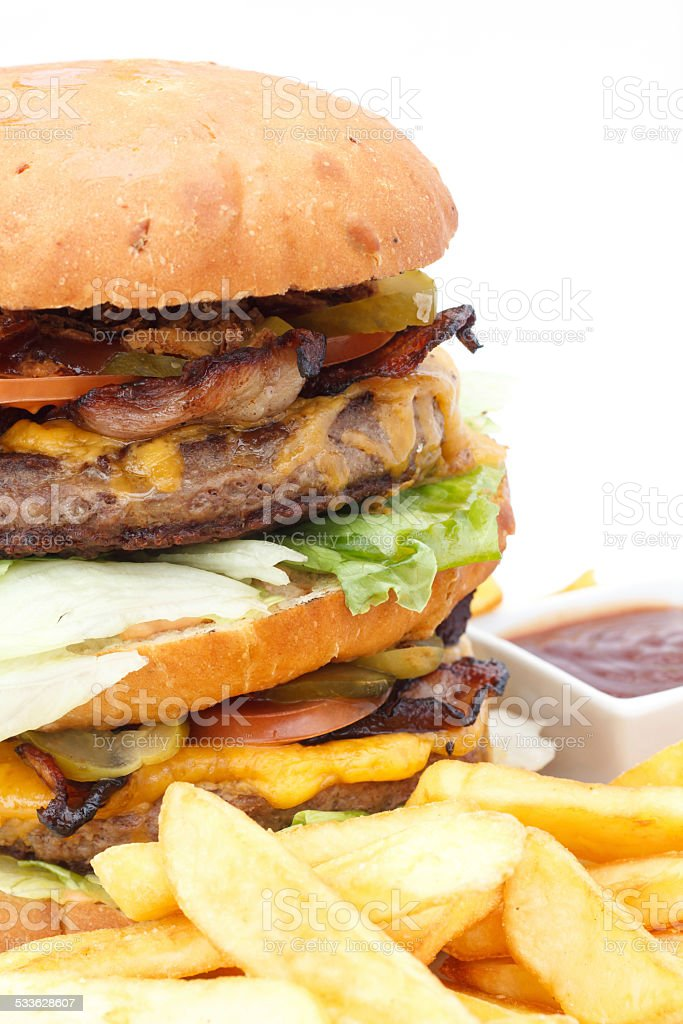 Double cheese burger and chips with ketchup stock photo