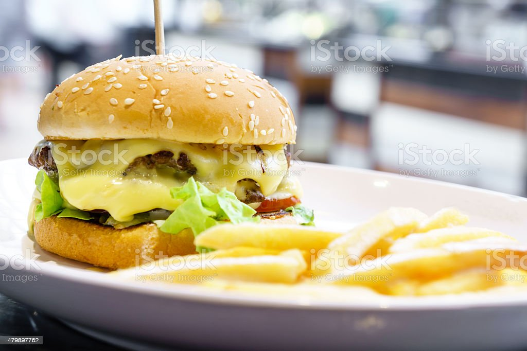 Double cheese burger and french fried stock photo