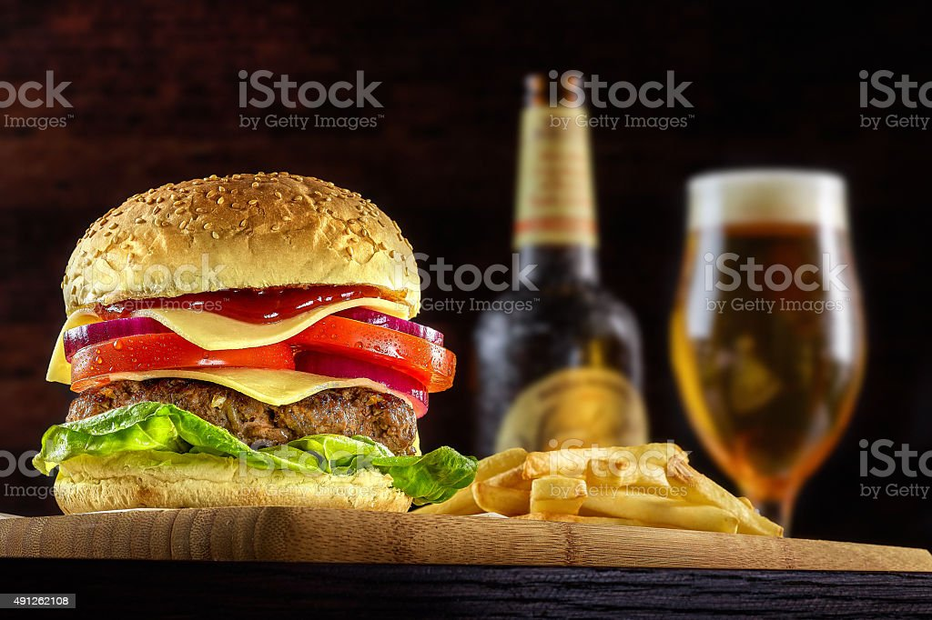 Double Cheese burger with ice cold beer stock photo