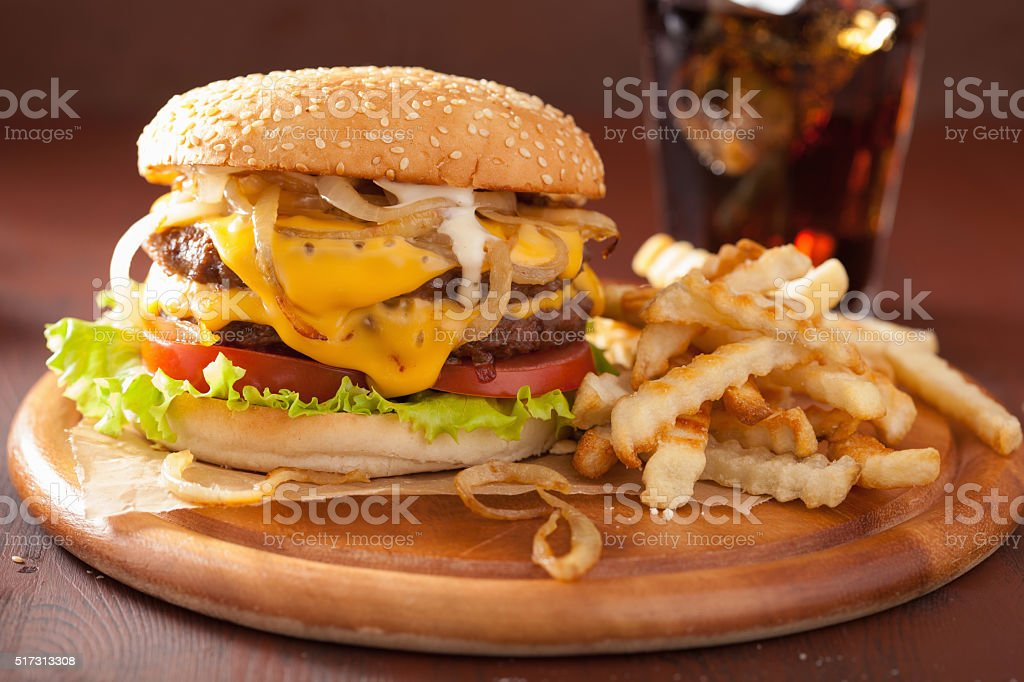 double cheeseburger with tomato and onion stock photo