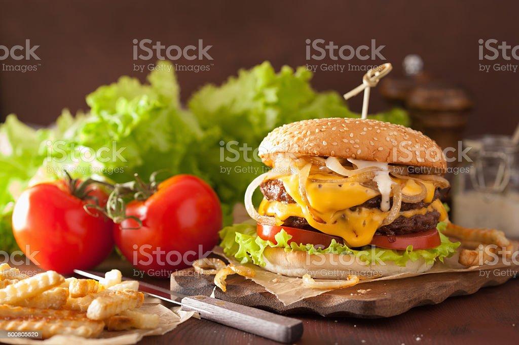 double cheeseburger with tomato onion stock photo