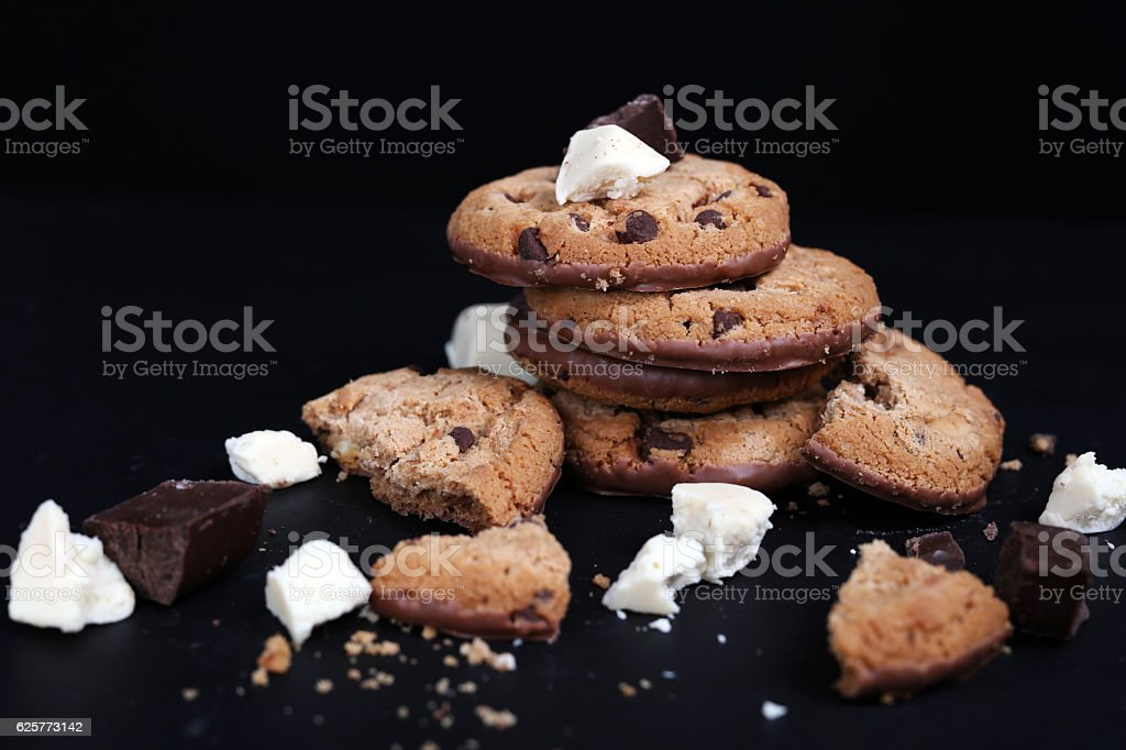 Double chocolate chip cookies on black background stock photo