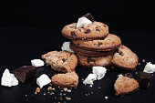 Double chocolate chip cookies on black background