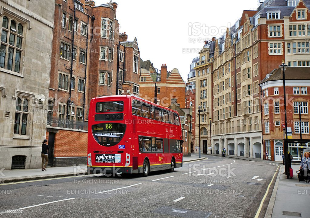 Double Decker Red Bus on Calm London Street royalty-free stock photo