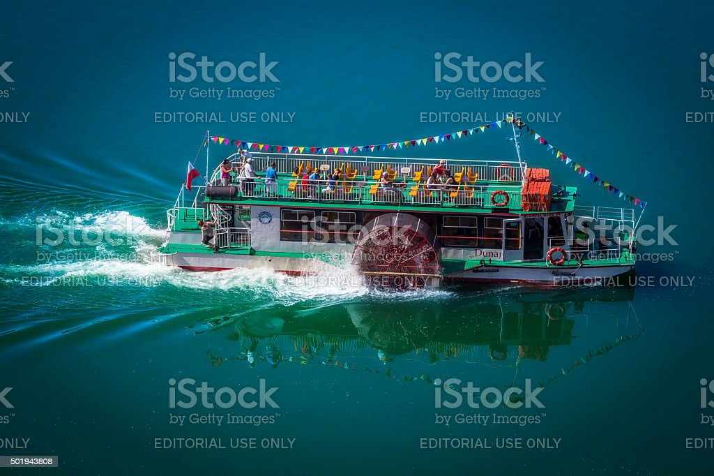 Double decker sightseeing boat on the lake stock photo