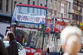 Double Decker Tour Bus Carrying Tourist Downtown Sydney