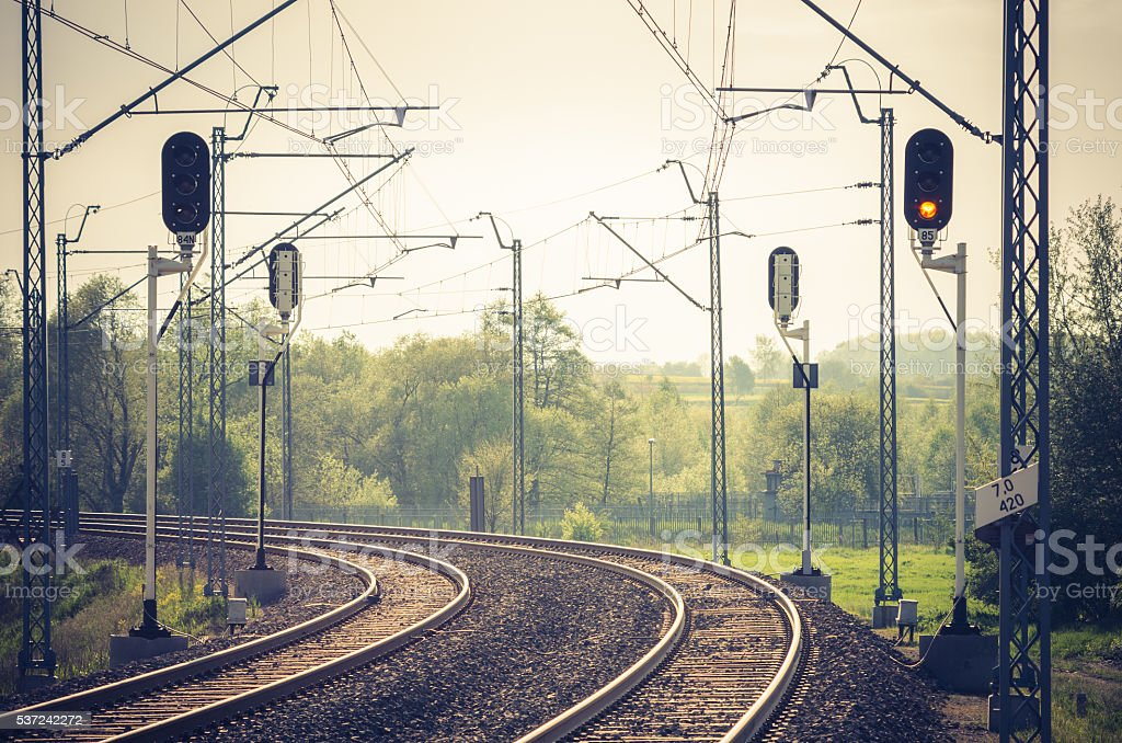 Double electrified railway track with railway signals stock photo