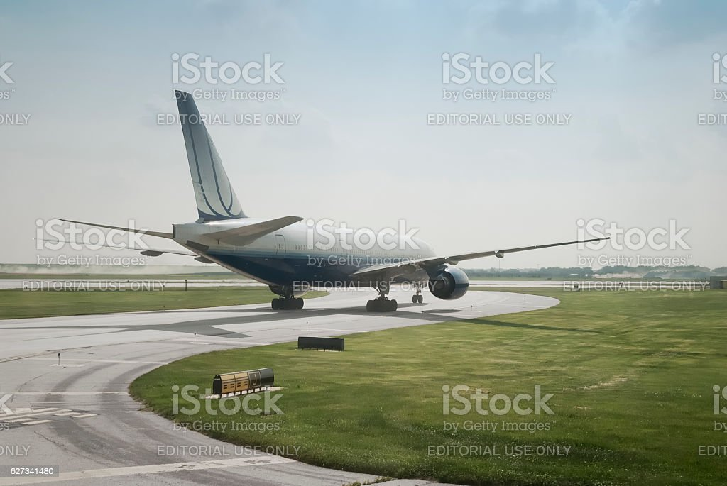 Double engine jet landing on a clear blue sky stock photo
