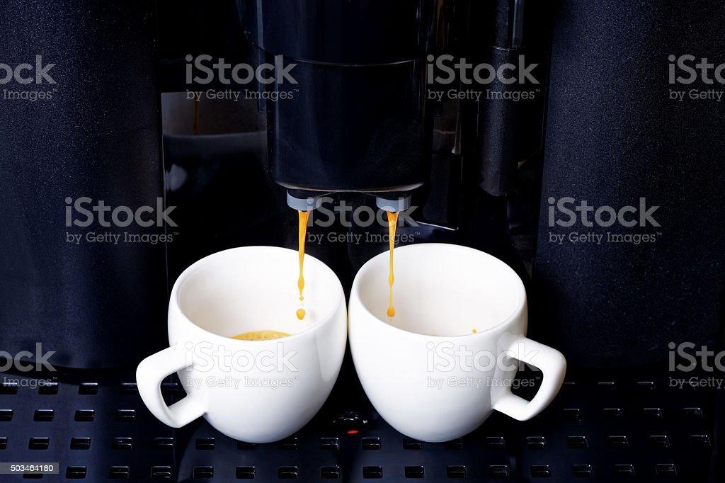 Double espresso preparation in coffee machine stock photo