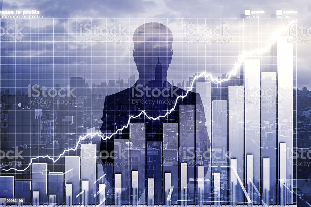 Double explosure with business chart and businessman silhouette stock photo