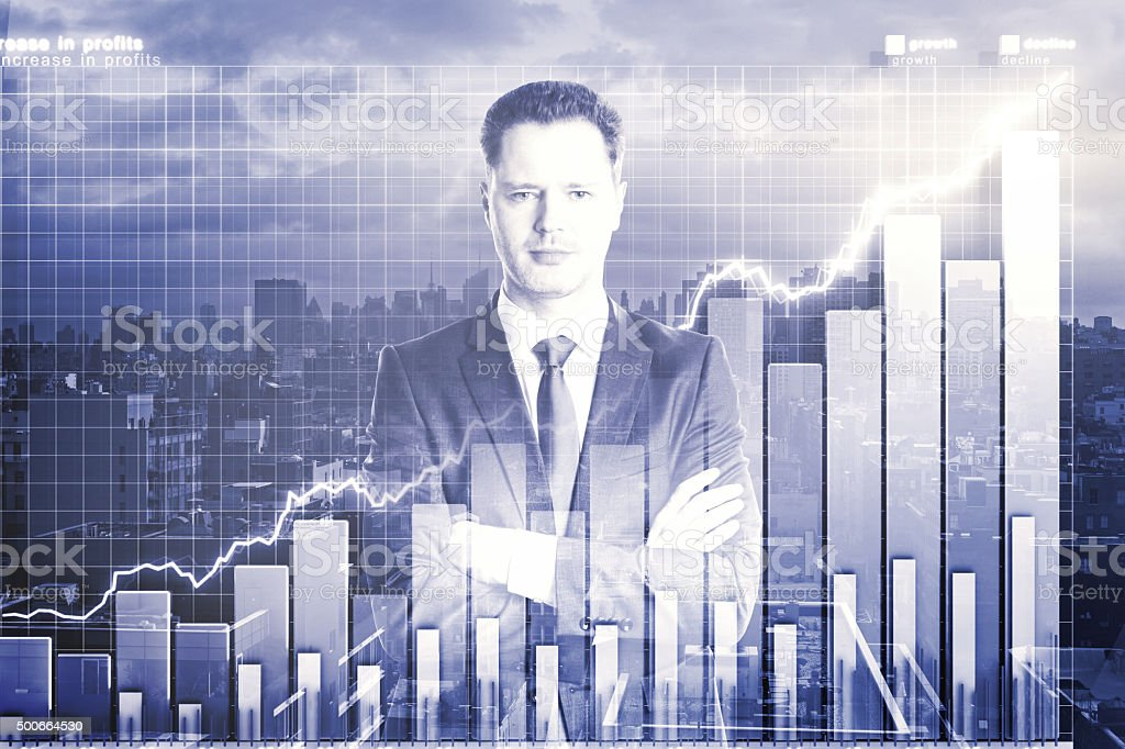 Double explosure with business graph and businessman stock photo