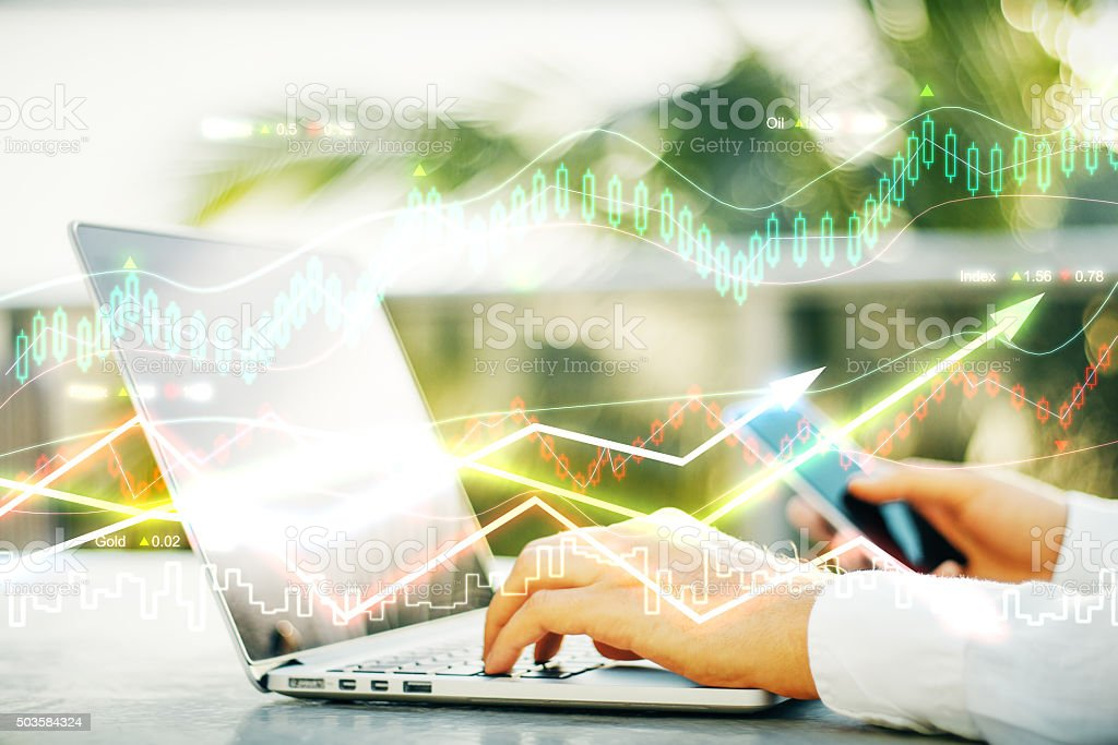 Double explosure with working businessman and business chart stock photo