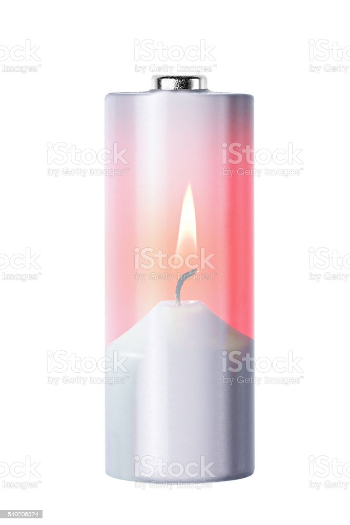 Double exposere of battery and burning candle, isolated on white stock photo