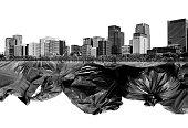 Double exposure black garbage bags and buildings