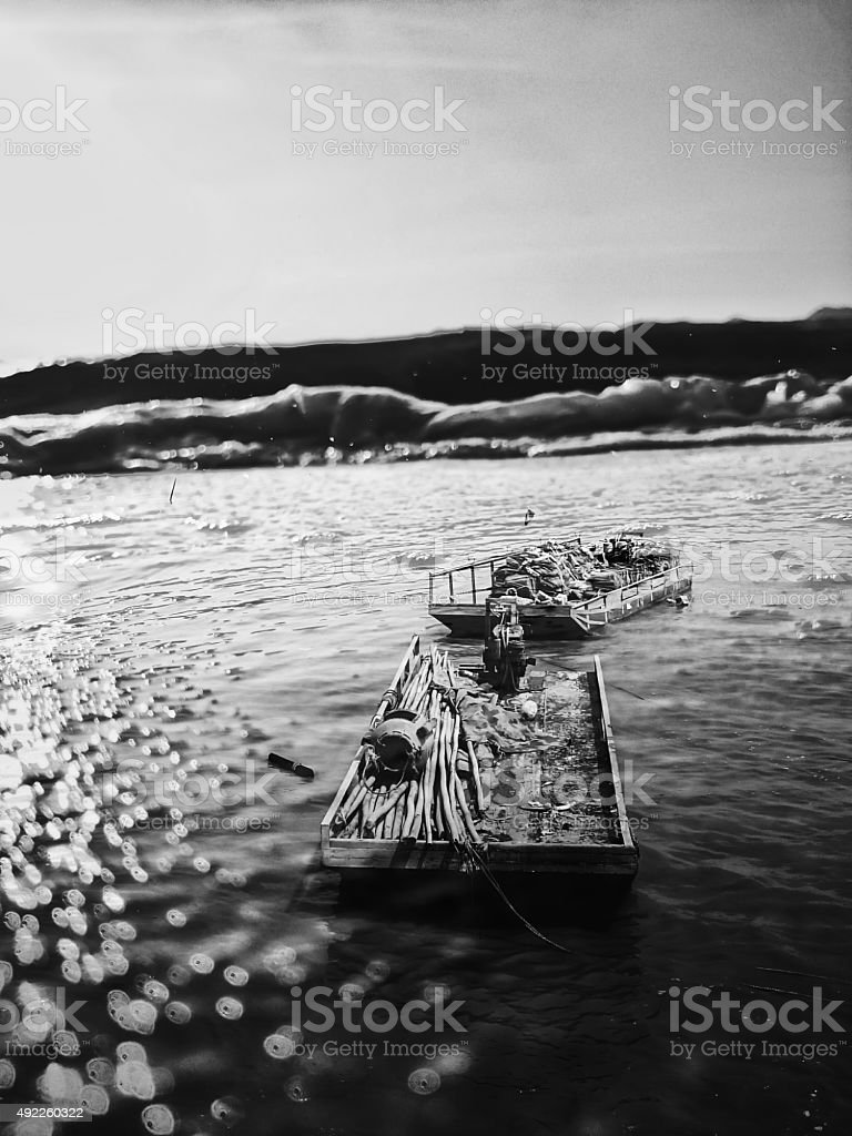 Double Exposure Boat against the Waves stock photo