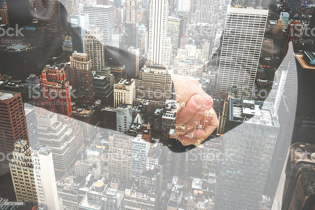 double exposure business handshake on the financial district stock photo