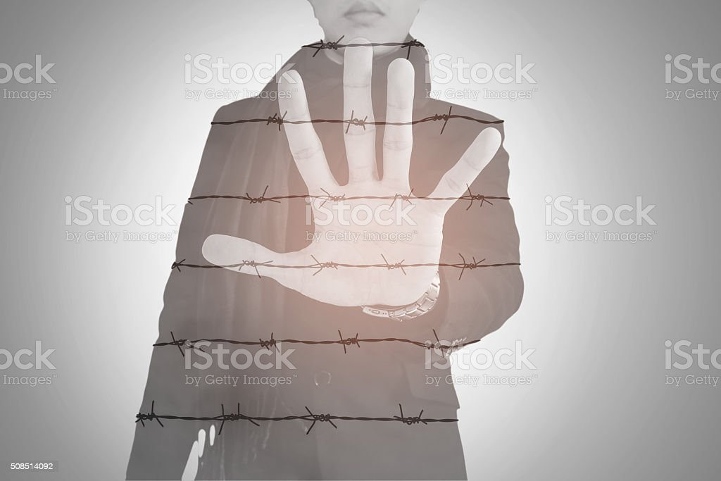 Double exposure, businessman show palm with barbed wire, abstract concept stock photo