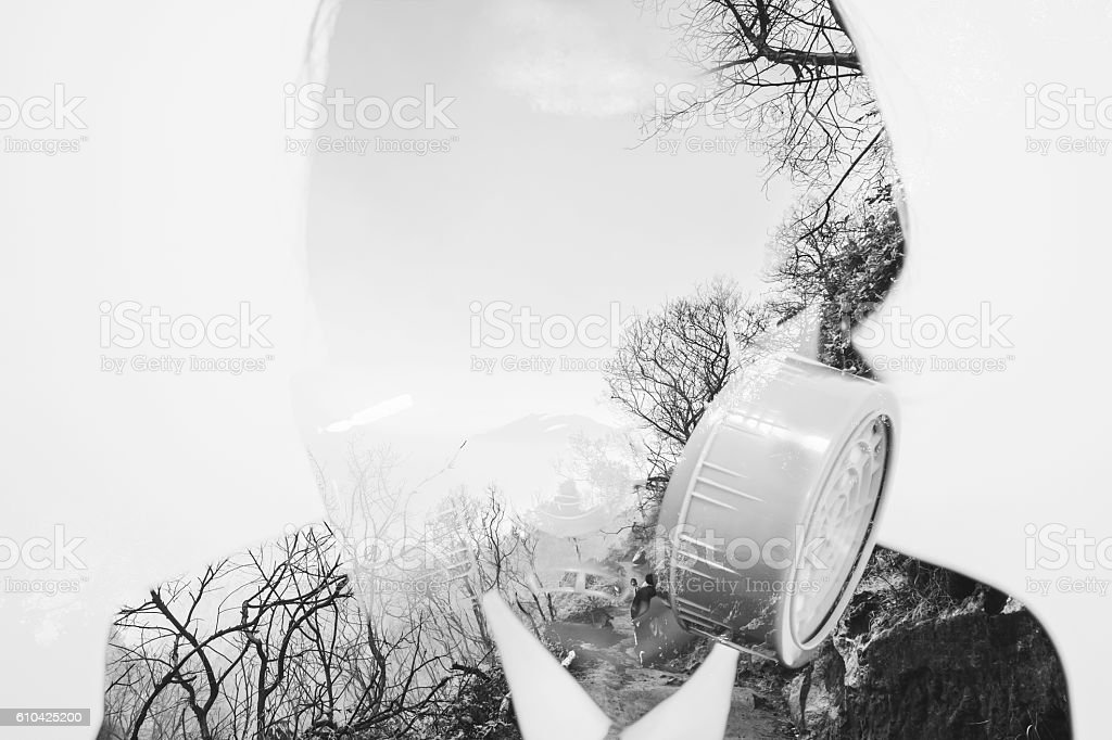 Double exposure, businessman wearing toxic protection mask with dead environment stock photo