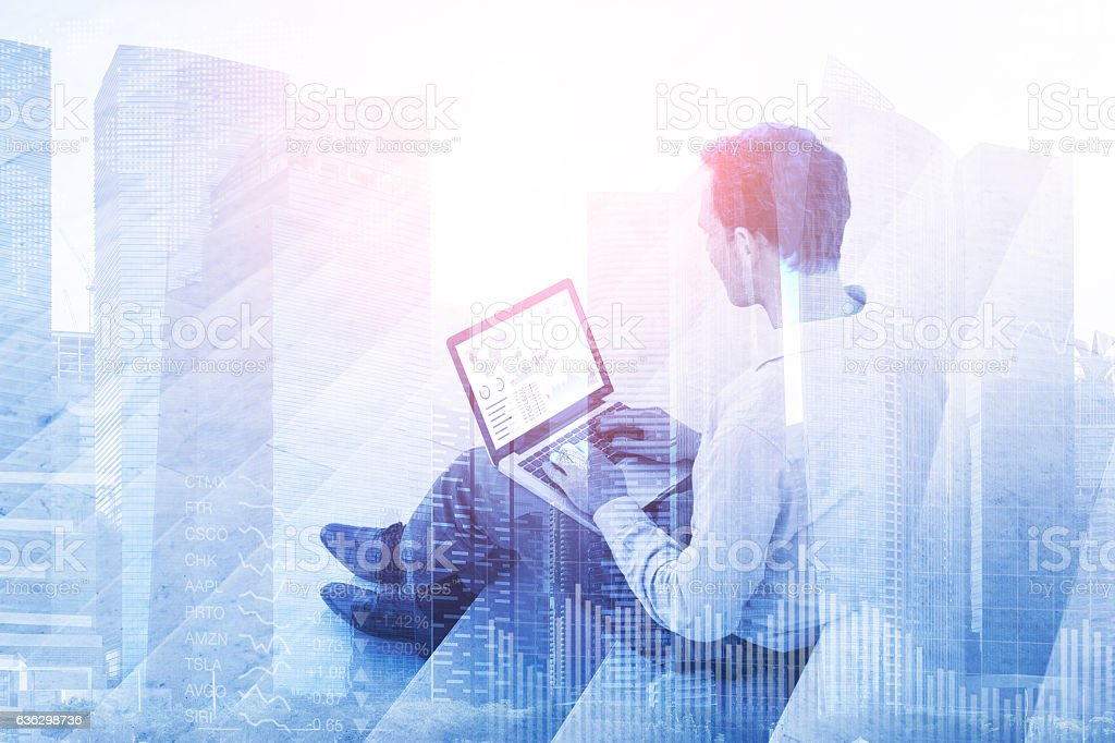 Double exposure businessman with stock market dashboard and financial buildings stock photo