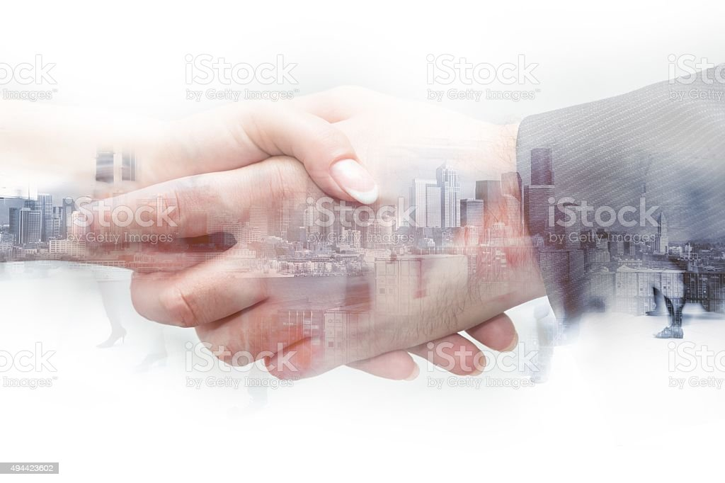 double exposure handshake woman and man on a city background stock photo