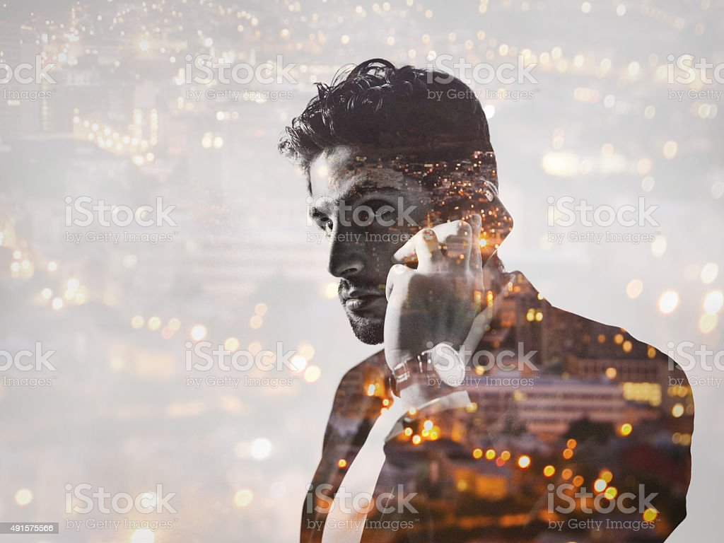 Double exposure image of businessman and city at night stock photo
