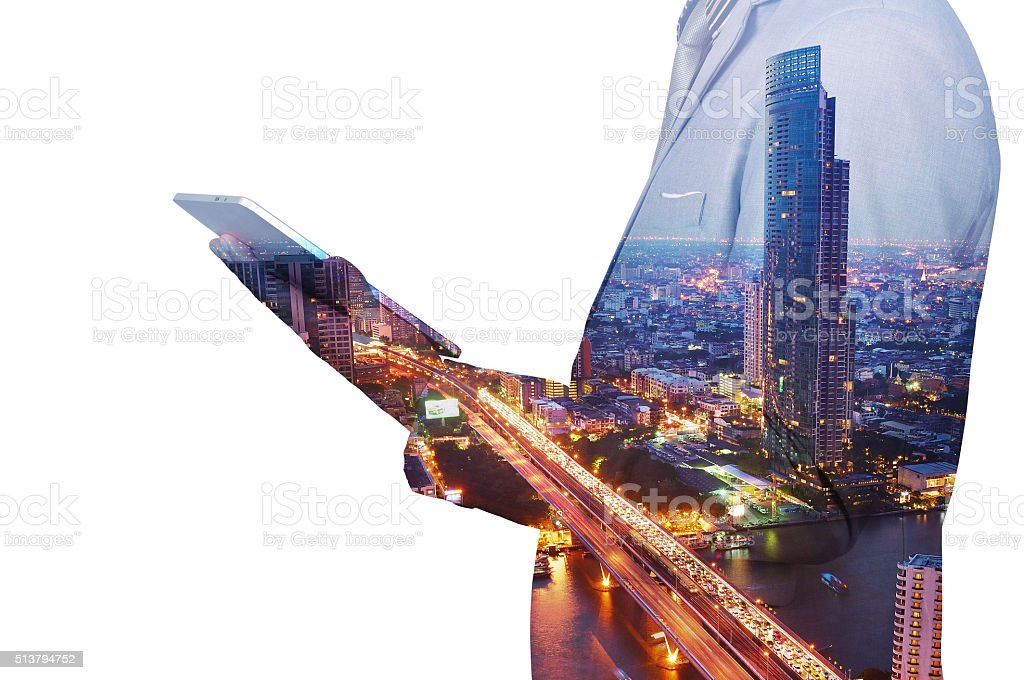Double Exposure image of Businessman use Digital Tablet and City stock photo