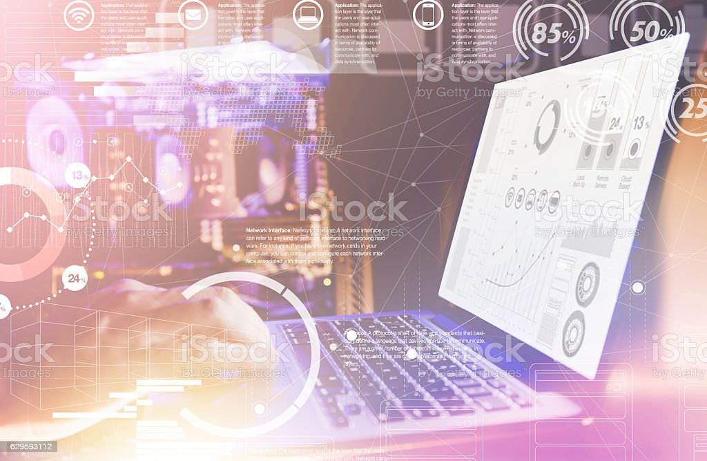 Double Exposure. Laptop with financial statistics on a desktop stock photo