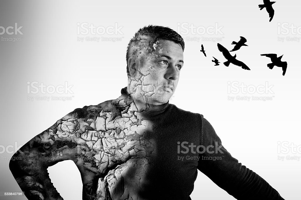 Double Exposure Male Portrait and Crows stock photo