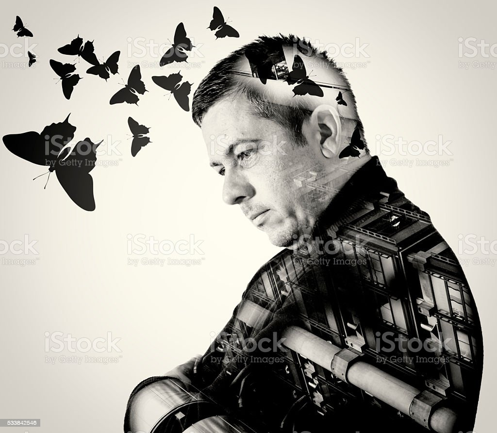 Double Exposure Man and Industry with Butterflies stock photo