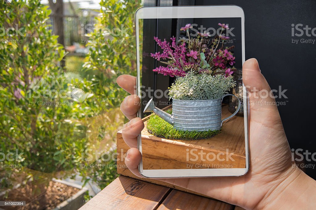 Double exposure mobile over blurred image in home stock photo