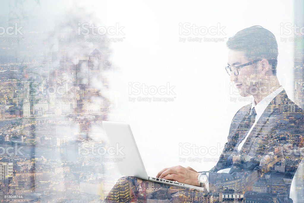 Double exposure of Asian businessman using the tablet stock photo