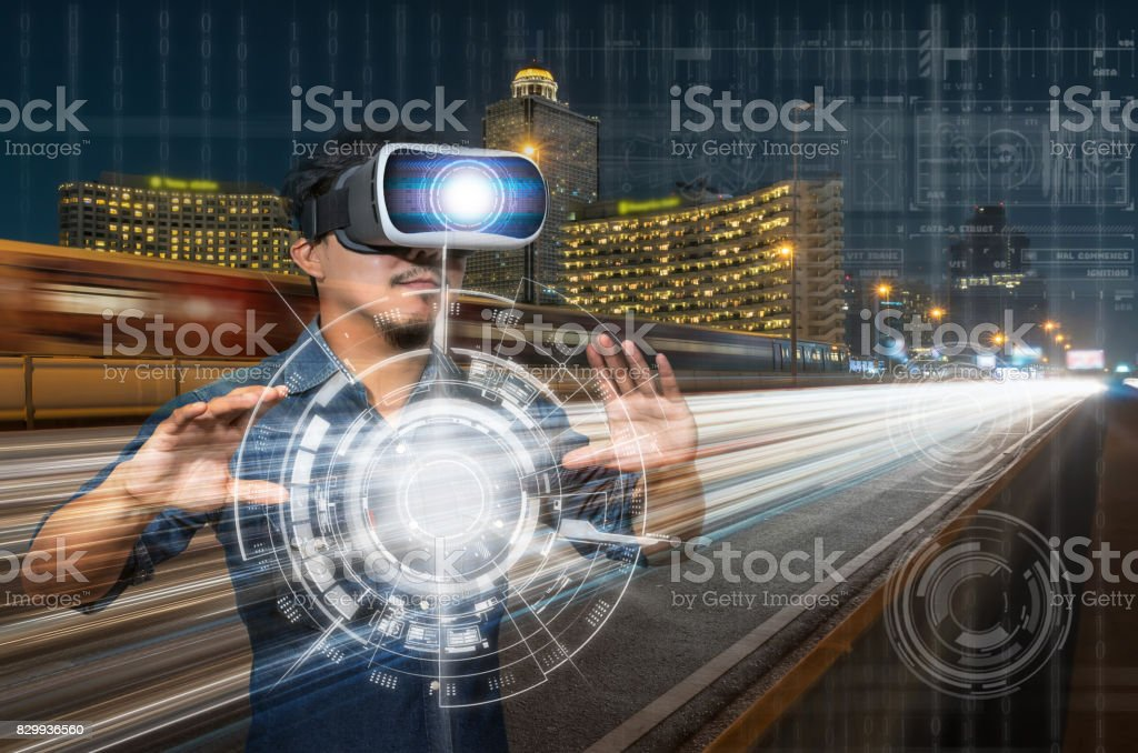Double exposure of Asian man wearing virtual reality over the light of the cars on the express bridge with digital technology background, VR with business technology concept stock photo