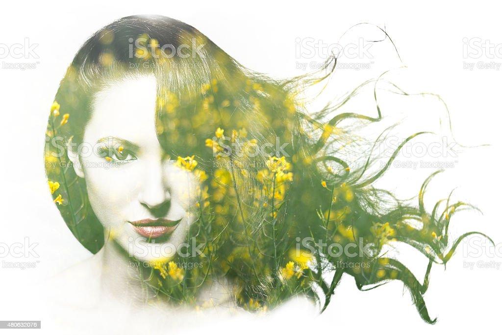 Double exposure of beautiful Caucasian woman stock photo