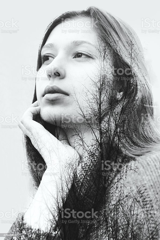 Double exposure of beautiful girl and leaves monochrome stock photo